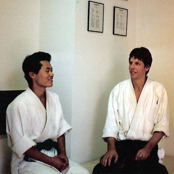 Koji sitting in seiza with Shihan Brian Workman in Hakkoryu Dojo