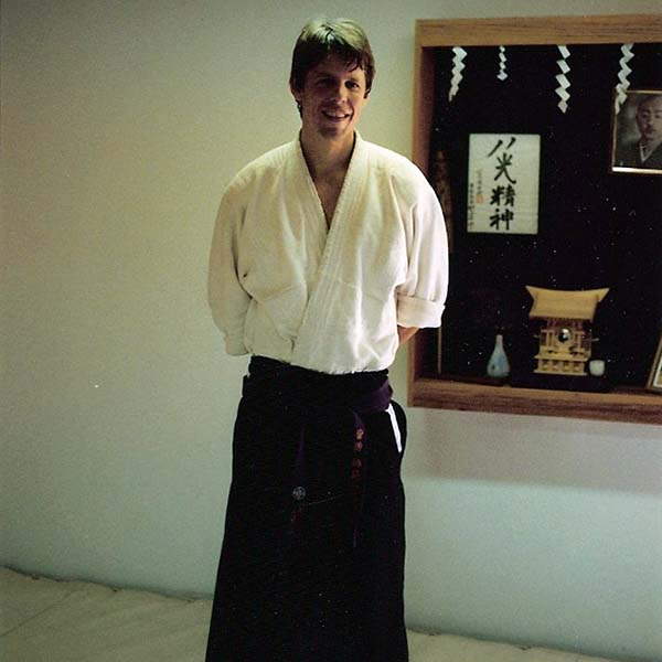 Shihan Brian W. Workman Smiling, Wearing Hakama in Dojo
